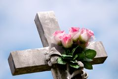 Stone Cross with Pink Roses royalty free stock photography