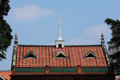 Stone cross on roof of Fujian-style architecture Stock Photo