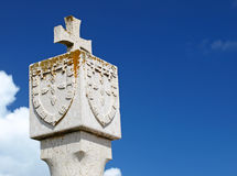 Stone cross and shield Royalty Free Stock Photography