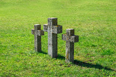 Stone Cross Sign. Close up side view of three stone cross signs in a meadow area, on green grass background Stock Photography