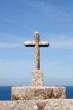 Stone cross on the Spanish coast Stock Photos