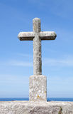 Stone cross on the Spanish coast Royalty Free Stock Images