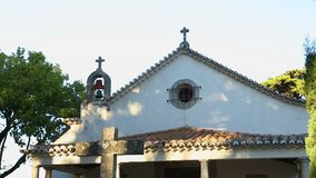 Stone cross standing front of small old chapel in Portugal, travel destination. Stock footage stock video footage