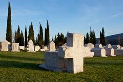 Stone cross and tombstones of medieval necropolis Radimlja Royalty Free Stock Photography