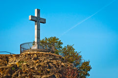 Stone cross at the top of a mountain Stock Photography