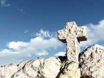 Stone cross under cloudy sky Stock Photo