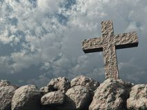 Stone cross under cloudy sky Stock Photos