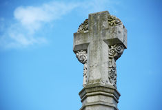 Stone cross war memorial outside Winchester Cathedral Stock Images