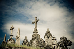 Stone crosses in a  cemetery in Galicia, Spain. Detail view of a  Catholic cemetery Royalty Free Stock Images