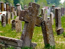 Stone crosses on cemetery. Old cemetery with stone monuments Stock Image