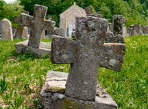 Stone crosses. Old cemetery with stone monuments Royalty Free Stock Photos
