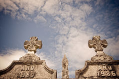 Stone Crosses and sky. Stone crosses in a Catholic cemetery and sky with clouds Stock Photography