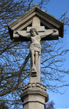 A stone crucifix statue Stock Photo