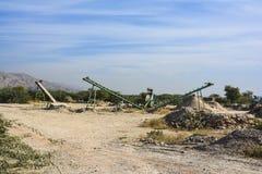 Stone Crusher. Stone crushing machine somewhere near Quaidabad, Khushab, Pakistan stock photo