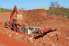 Stone crusher and digger Royalty Free Stock Photos