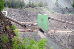 Stone crusher machine in an open pit mine Royalty Free Stock Photo