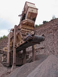 Stone crusher in porphyry surface mine. hdr image Royalty Free Stock Photo