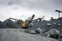 Stone crusher in surface mine quarry Royalty Free Stock Images