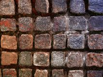 Stone cube as a solid backgrund - detail from the street. Detail from the street - stone cube as a interesting backdrop - wallpaper royalty free stock photo
