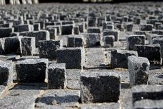 Stone cubes background on the pavement royalty free stock images