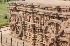Stone culptures of Indian temple. Bullock cart wheel carved out of stone symbolizes a moving temple stock images