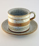 Stone cup and saucer Stock Image