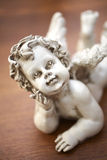 Stone cupid doll Royalty Free Stock Photo