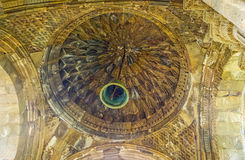 The stone cupola. The carved patterns of the porch's dome of St Peter and Paul Cathedral in Tatev Monastery with the old bell, hanging in the middle, Tatev Stock Photo