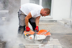 Free Stone Cutter At Work On Construction Site. Royalty Free Stock Photos - 48944248