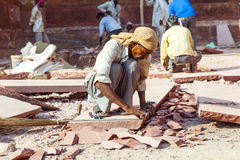 Stone cutter at the Red Fort in Agra, Amar Singh Gate, India, Uttar Pradesh Stock Images