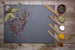 Stone Cutting Board And Spices Royalty Free Stock Photo