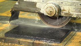 The machine saws black marble stock video footage