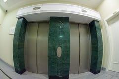 Stone decorated elevator stock photography