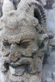 Stone demon carving face sculture gargoyle stock photos