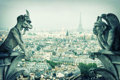 Stone demons gargoyle und chimera. Notre Dame de Paris Stock Photo