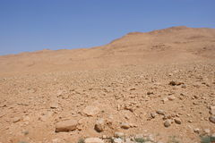 Stone desert and blue sky Royalty Free Stock Image