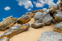 Stone desert on  blue sky and white clouds background. Royalty Free Stock Photo