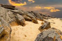 Stone desert on fantastic sunset background . Royalty Free Stock Image