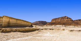 Stone desert in Israel. Rocky hills of the Negev Desert in Israel. Breathtaking landscape of the desert rock formations in the Southern Israel Desert Stock Image