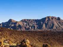 Stone desert. Volcanic landscape - stone - sand - hills - blue sky - bright daylight Royalty Free Stock Image