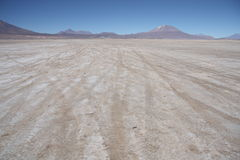 Stone deserted plain with car traces Royalty Free Stock Image