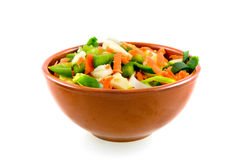 Stone dish with various vegetables. On white background stock photo