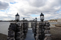 Stone Dock. A dock made out of stone leading to the water Royalty Free Stock Images
