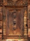 Stone door in Banteay Srei temple near Angkor Wat. Royalty Free Stock Photography
