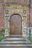 Stone Door Frame. Wooden Arched Door with Decorative Stone Frame Stock Image