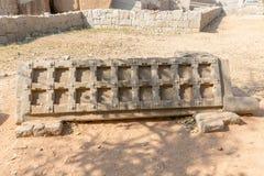 Stone door leaf next to Mahanavami platform monument, Hampi. Karnataka, India, Asia stock photo