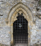 Stone door or window with bars. In England Royalty Free Stock Photos