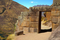 Stone doorway at Pisac ruins. Cusco, Peru. Stone doorway at Pisac ruins. Sacred Valley, Cuzco, Peru, South America Stock Photo