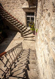Stone double staircase at backyard of ancient house Royalty Free Stock Photo