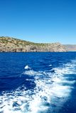 Stone Dragon. Steep banks and cliffs, towering menacingly over the waters blue Mediterranean Sea. But in their eternal struggle, there are no winners and losers Stock Photography